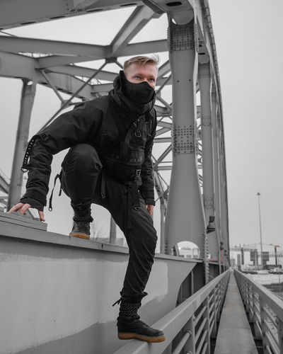 Urban Ninja, Urban, Urban Fashion, Fashion, ninja Real People Architecture Day Full Length One Person Lifestyles Built Structure Men Casual Clothing Railing Leisure Activity Standing Transportation Bridge - Man Made Structure Bridge Connection Young Adult Young Men Outdoors Warm Clothing