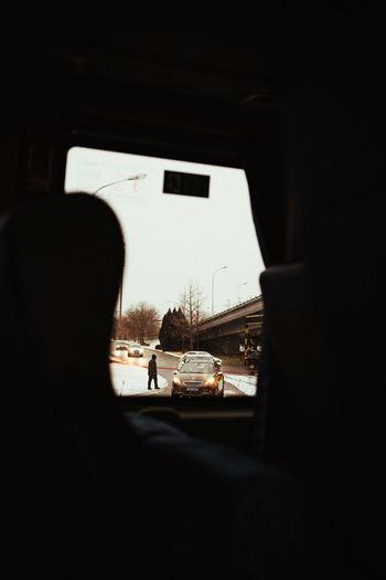 Rear view of silhouette man seen through car window