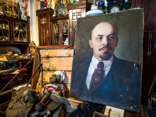 Russia, Kolomna, antique shop, Lenin's portrait Lenin's Portrait Russia Adult Antique Shop Art Beard Facial Hair Front View Human Representation Indoors  Kolomna Lifestyles Looking At Camera Males  Mature Adult Mature Men Men Mid Adult Mid Adult Men One Person Portrait Real People Sitting Tourism