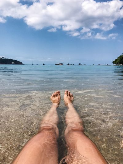 Sea Water Relaxation Beach Barefoot One Person Horizon Over Water Sand Human Leg Sky Low Section Sunlight Real People Vacations Scenics Nature Shallow Human Body Part Outdoors Beauty In Nature Personal Perspective Clear Water Vacations Beach Life Islandlife
