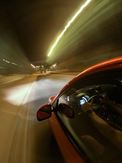 Car moving on illuminated road at night