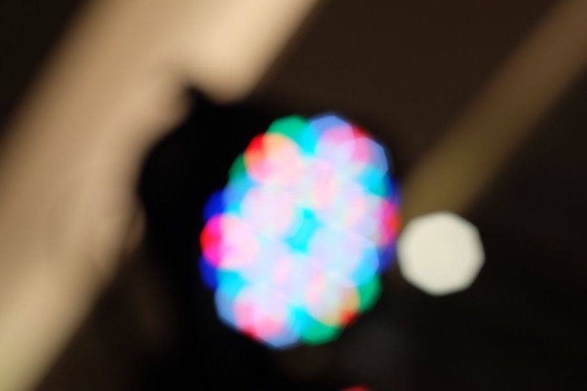Colorful Bokeh Light Multi Colored One Person Real People Illuminated Close-up Food Human Hand Indoors  Night Human Body Part