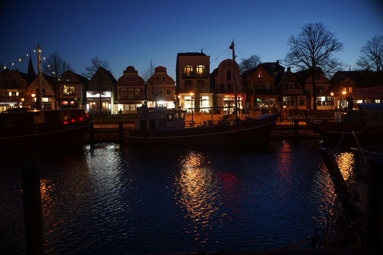 View of canal in city at night
