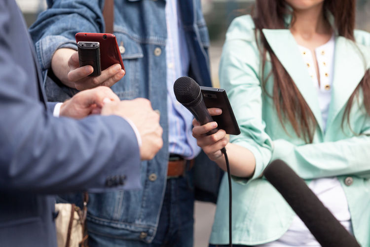 Journalists making media interview Event Interview Journalist Press Announcement Broadcasting Comment Communication Conference Gesture Gesturing Hand Information Journalism Media Microphone News People Public Public Relations Report Reporter Speaking Talking