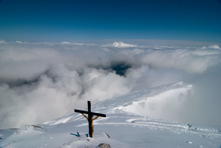 Beauty In Nature Cloud - Sky Cold Temperature Cross Day Gipfelkreuz Low Angle View Mountain Nature No People Outdoors Religion Scenics Sky Snow Tranquil Scene Tranquility Watzmann Watzmann-Hocheck Winter