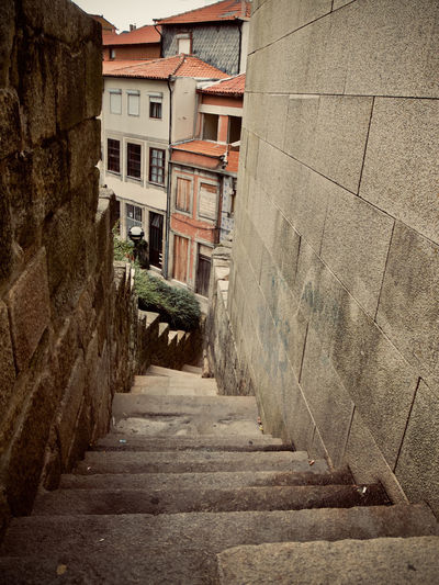 City Cityscape Oporto, Portugal Portugal Alley Architecture Building Building Exterior Built Structure City Color Day Direction Empty Footpath House Narrow Nature No People Outdoors Residential District Staircase The Way Forward Wall Wall - Building Feature