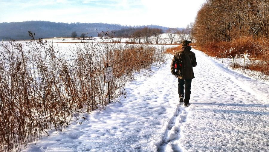 """I am following him and trying to step where he does. You cannot tell, but it was deep. But I would follow my baby anywhere. This considered a """"must-see destination in PA because of the geese migration on the lake. Anythingfortheshot Streamzoofamily Nature_collection Wildlife & Nature Winterscapes"""