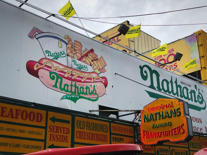 Nathan's Hot Dogs at Coney Island. EyeEm New Here Coney Island Nathan's Hot Dogs Hot Dogs Text Communication Western Script Architecture No People Coney Island Nathan's Hot Dogs Hot Dogs Text Communication Western Script Architecture No People