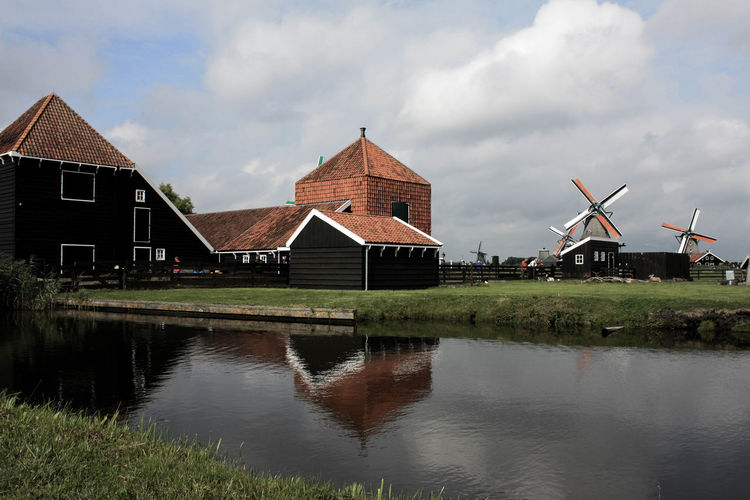 Traditional Dutch Village Windmill Architecture Building Building Exterior Built Structure Cloud - Sky Environment House Nature No People Outdoors Reflection Sky Water Wind Power
