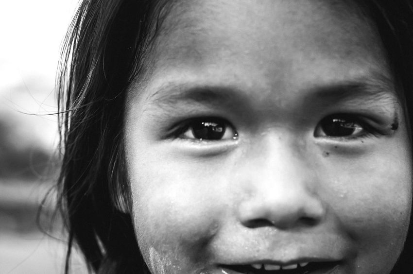 He lives in a former landfill. He plays in the dirt road where raw sewage runs through the street, but he is happy. Beyond The Border Mexico Poverty Children Project Esperanza Border Stories Blackandwhite Black And White Black And White Photography Black And White Portrait The Photojournalist - 2016 EyeEm Awards The Portraitist - 2016 EyeEm Awards The Following Natural Light Portrait