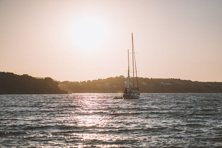 Lost In The Landscape Beauty In Nature Lens Flare Mast Nature Nautical Vessel No People Outdoors Sailboat Sailing Sailing Ship Scenics Sea Silhouette Sky Summer Sun Sunlight Sunset Travel Destinations Vacations Water Yacht Yachting