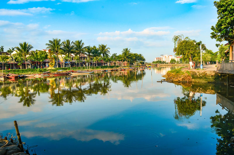 Architecture Beauty In Nature Built Structure Cloud - Sky Coconut Palm Tree Day Lake Nature No People Outdoors Palm Tree Plant Reflection Scenics - Nature Sky Swimming Pool Tranquil Scene Tranquility Tree Tropical Climate Water Waterfront