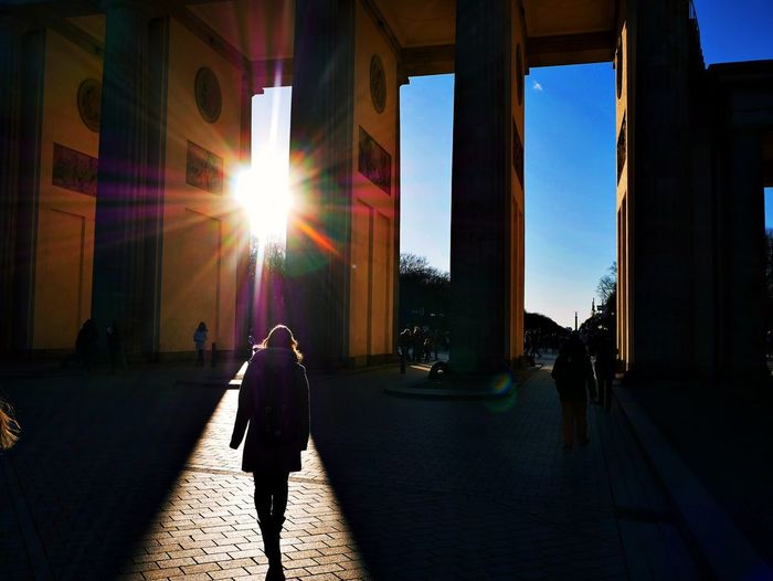 A path to another world? I love this shot. Looks so unreal in my eyes. And thanks to my sister to be the model ⛩️ In Adult Adults Only Architecture Back Lit Building Exterior Built Structure Day Lens Flare Nature One Person Outdoors People Silhouette Sun Sunbeam Sunlight Sunset The Secret Spaces ColeurArt The Portraitist - 2017 EyeEm Awards
