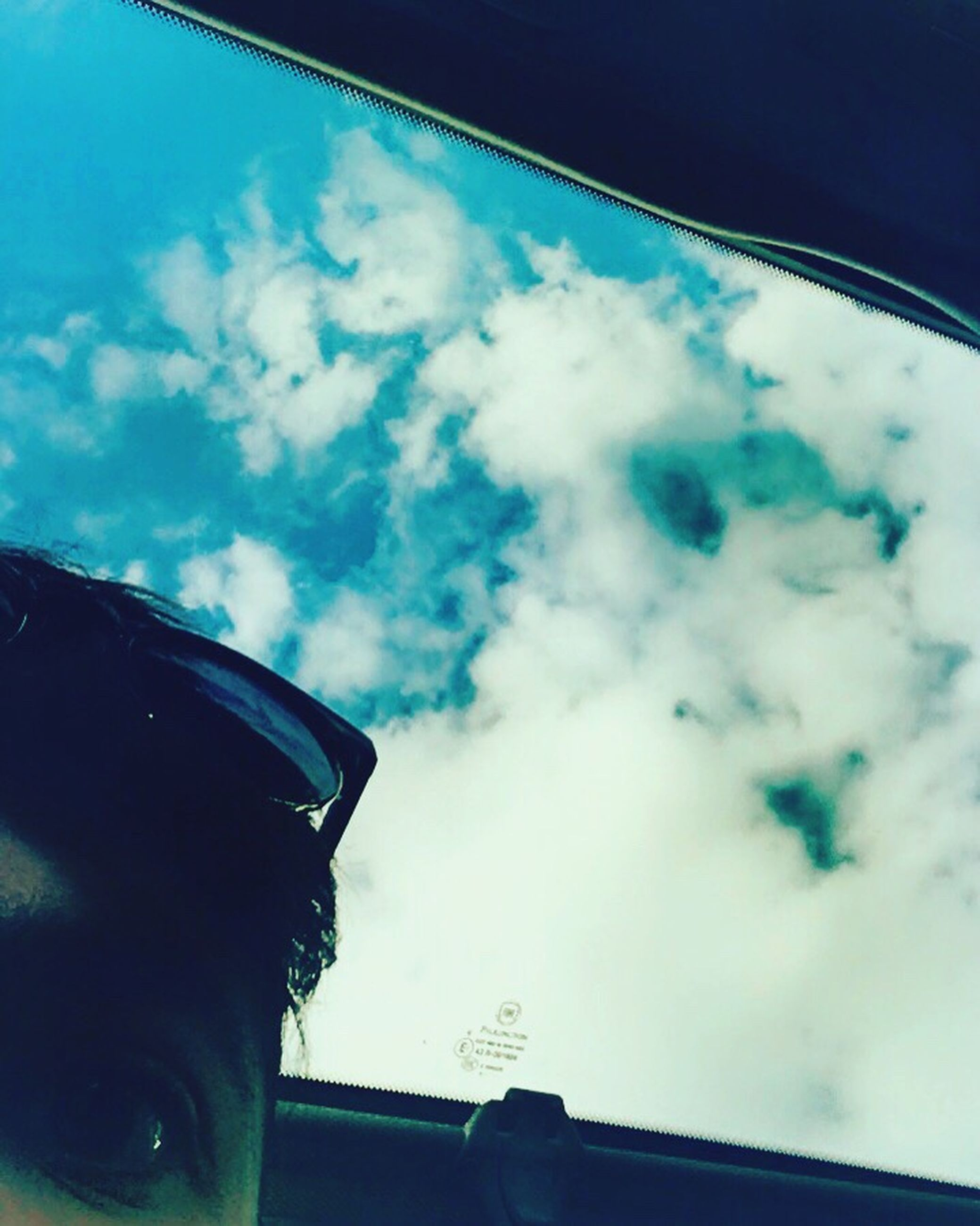 window, transportation, mode of transport, cloud, low angle view, cloud - sky, land vehicle, sky, day, outdoors, blue, no people, cloudscape, scenics