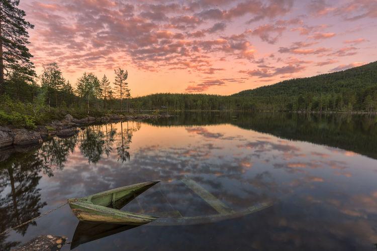 SCENIC VIEW Sunken Canoe In LAKE AT Dusk