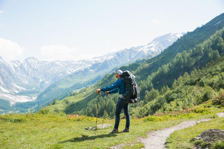 Full length of man on mountains against sky