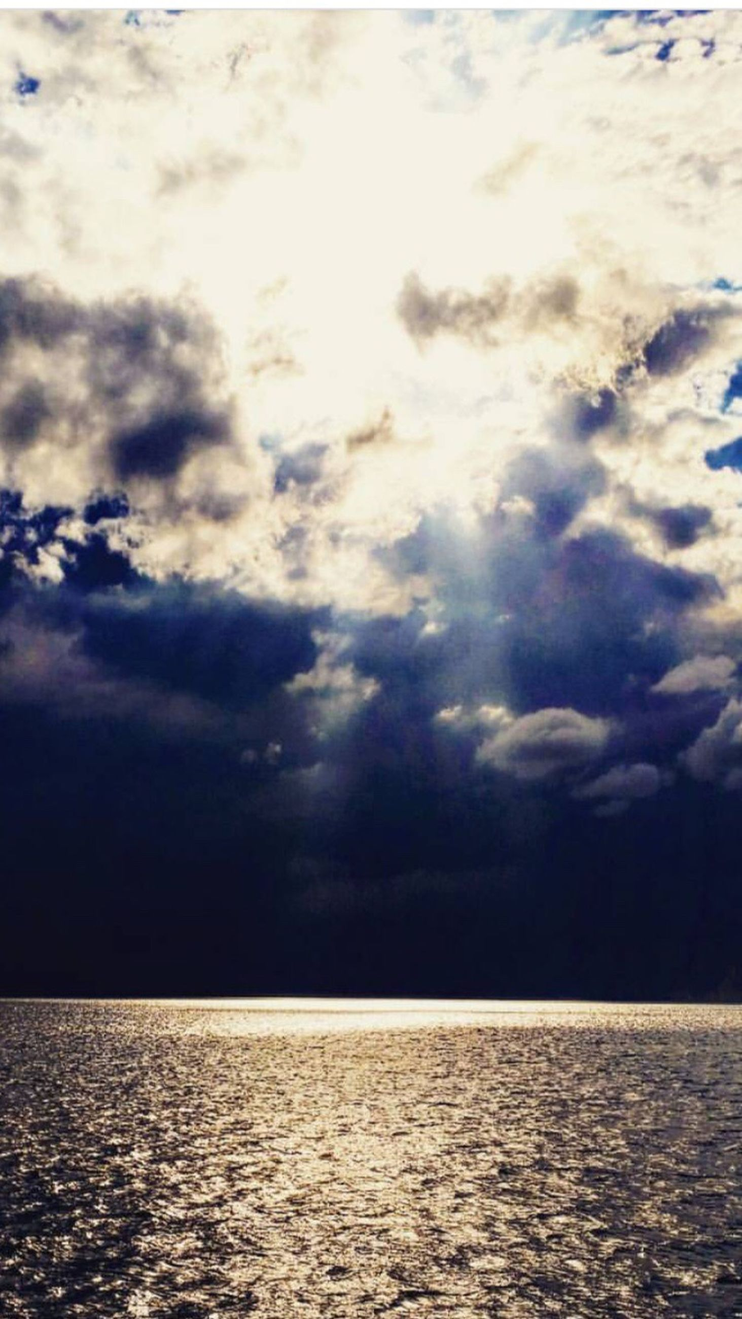sea, scenics, water, tranquil scene, horizon over water, waterfront, tranquility, beauty in nature, idyllic, nature, sky, cloud, calm, majestic, seascape, rippled, cloud - sky, blue, non-urban scene, ocean, remote, day, outdoors, dramatic sky, cloudscape, cloudy, tourism, no people, atmospheric mood