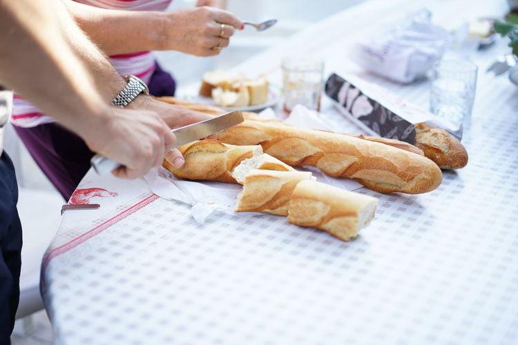 Cropped image of hands preparing food