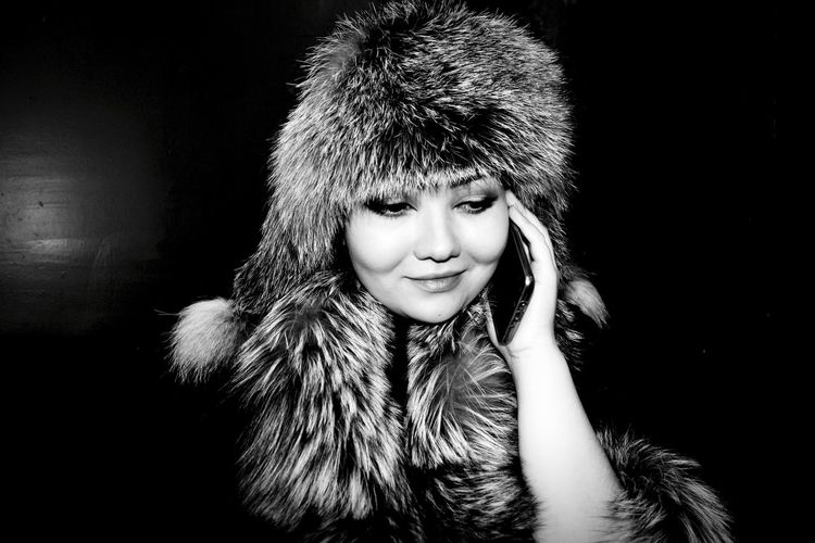Lady in furs Phone Call Conversation Pleasant Child Studio Shot Human Face Portrait Females People Close-up Adult Happiness Human Body Part