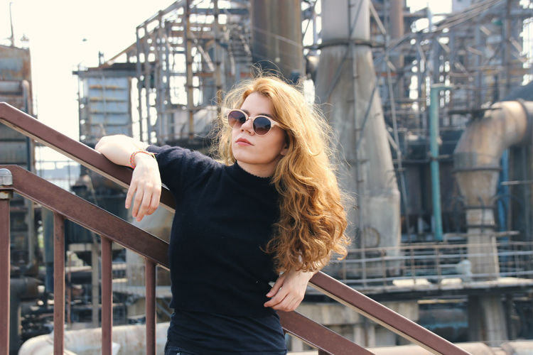 One Person Glasses Hair Architecture Hairstyle Sunglasses Built Structure Railing Fashion Long Hair Real People Standing Young Adult Lifestyles Focus On Foreground Leisure Activity Young Women City Beautiful Woman Outdoors 798 Art Zone 798艺术区 798 Beijing Beijing, China Hipster Hipster - Person Posing Posing For The Camera Industrial Industrial Landscapes Modern Modern Architecture Modern Art