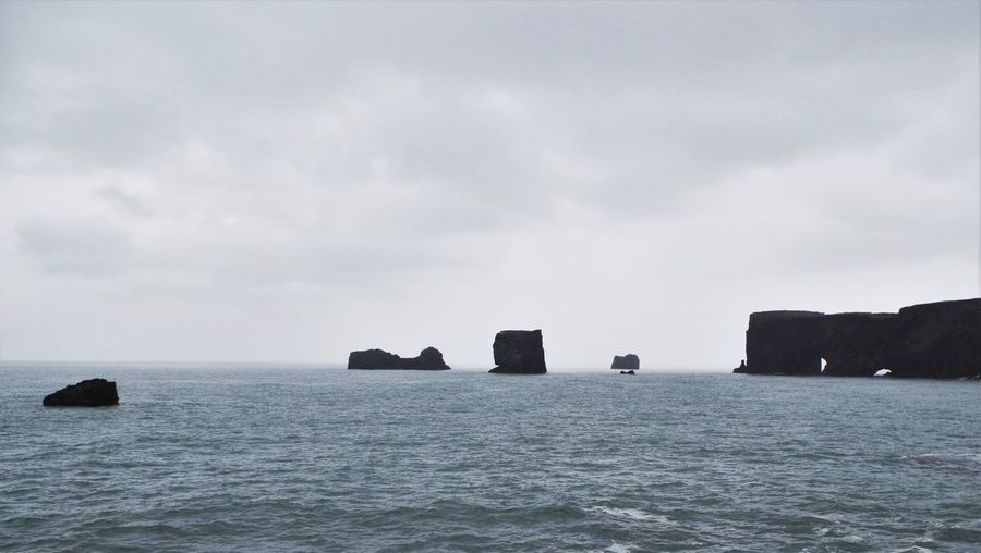 view from Dyrholaey in southern iceland. Black Sand Beach Cloud - Sky Coastline Day Dyrhólaey Horizon Over Water Iceland Nature No People Outdoors Reynisfjara Rock - Object Rock Formation Rocks Scenics Sea Sky Tranquil Scene Tranquility Water Waterfront