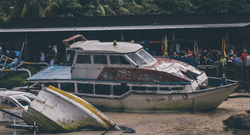 Boats moored on shore