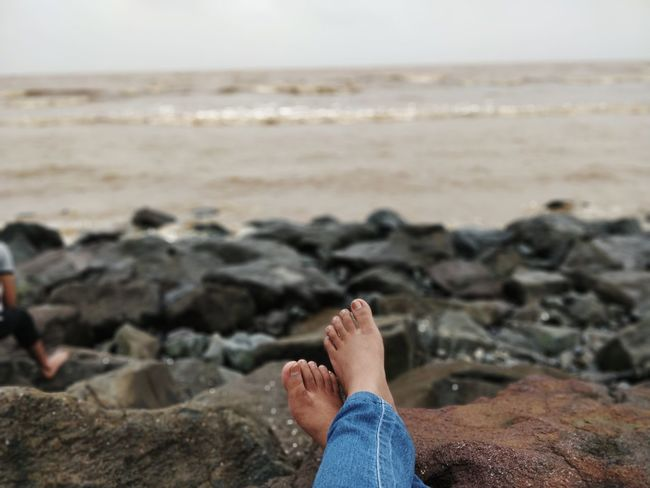 Peace of mind😇 Water Sea Beach Sand Wave Human Foot Rocky Coastline Coastline Ocean Calm Shore Coastal Feature Summer In The City EyeEmNewHere