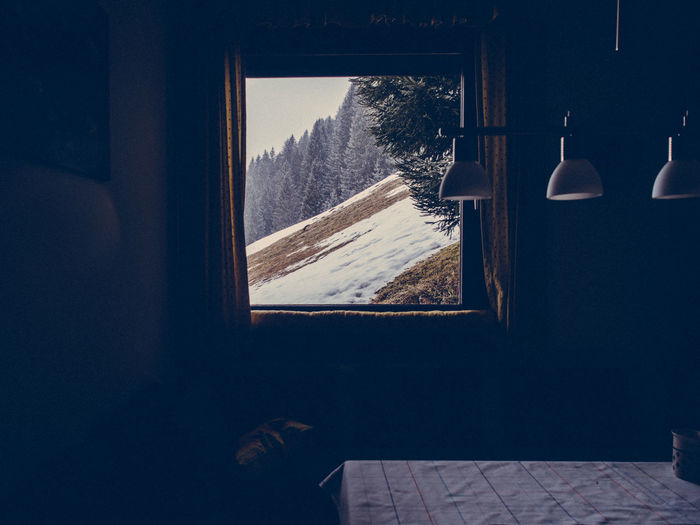 Mountain Seen Through Window During Winter