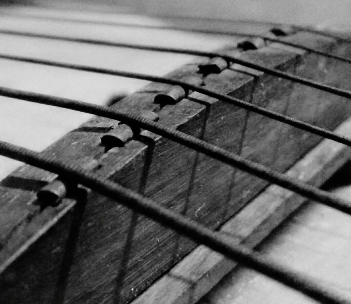 The bridge and the crossing strings. Taking Photos Black And White Photography Tunes Music Lovers EyeEm Best Shots Music Strings Attached Strings Guitar Blackandwhite Learn & Shoot: Simplicity Learn & Shoot: Leading Lines Distinctively Simple Still Life StillLifePhotography Composition Showcase: February Macro Photography Macro Guitarist Closeup EyeEm Best Edits Check This Out EyeEm Gallery
