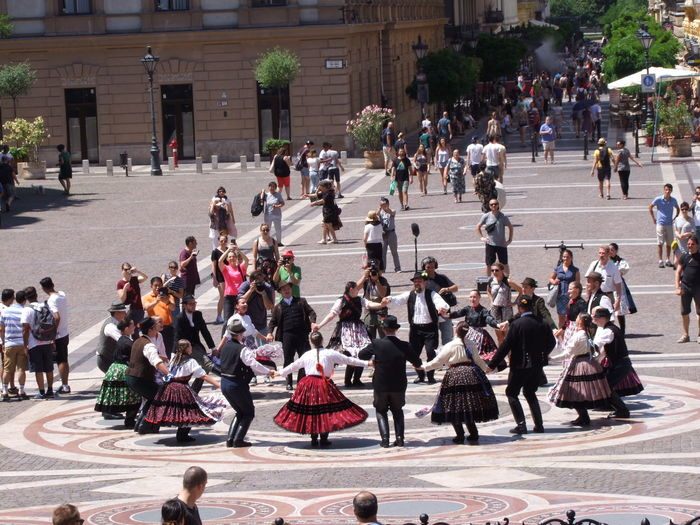 Hungarian Dancers in Saint Stephens Square Budapest Composition Fun Hungarian Dance Hungary Square Trees Unusual Circle Of Dancers Dancers Full Frame Hungarian Dancers Large Group Of People Men And Women Outdoor Photography People Performance Performance Group Real People Round And Round We Go Sunlight And Shadows Traditional Costumes