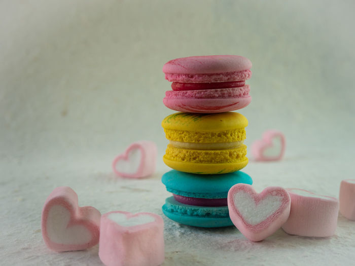 Macaroons and marshmallow on table