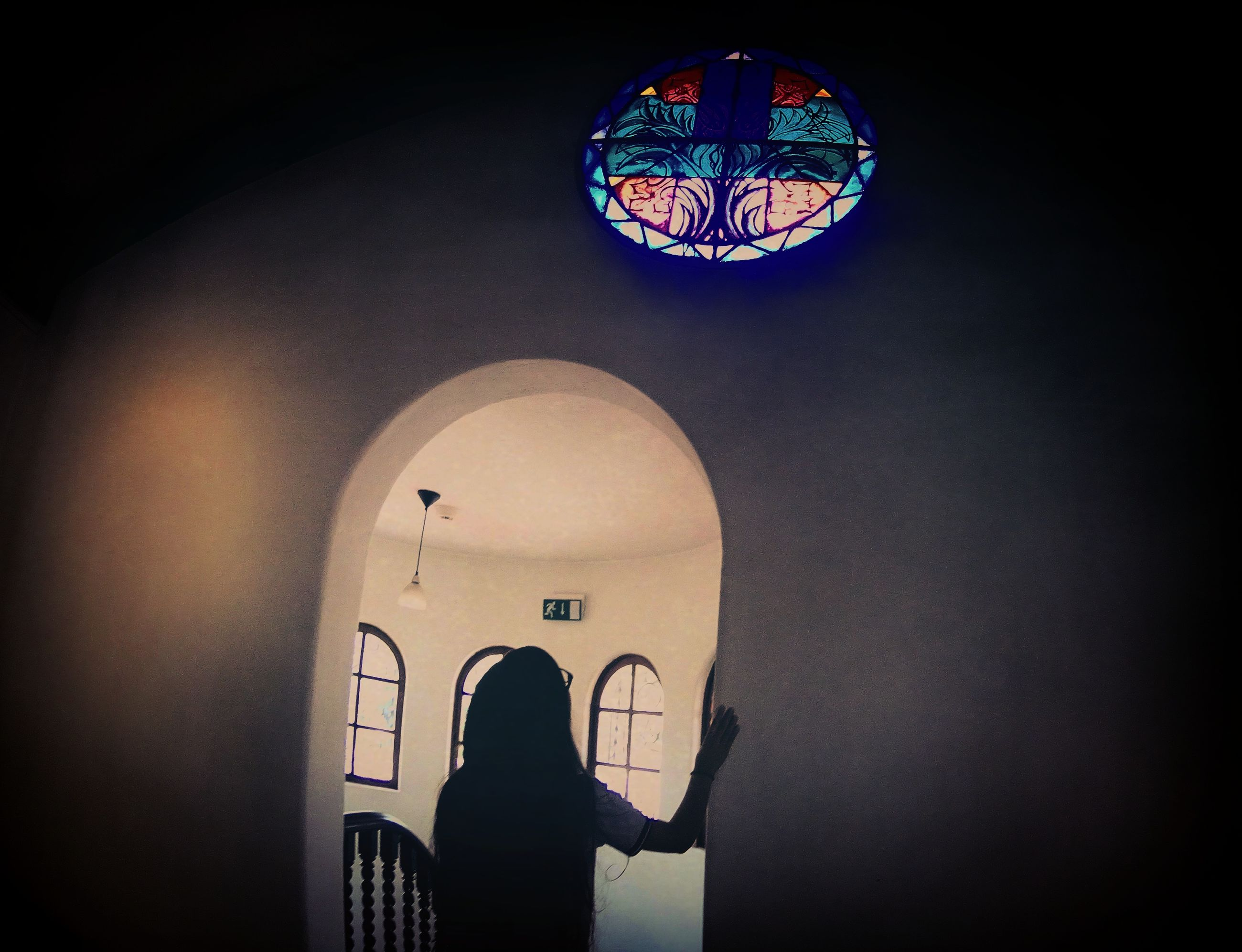 indoors, architecture, low angle view, built structure, arch, illuminated, religion, church, place of worship, night, spirituality, silhouette, leisure activity, dark, lifestyles, design