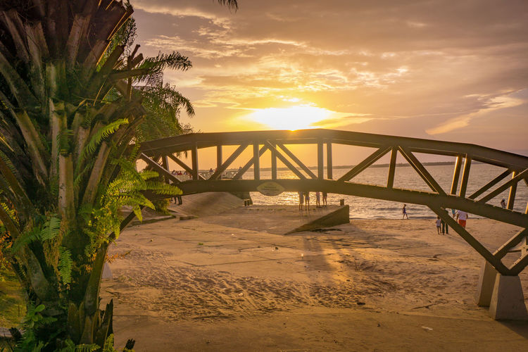Beach Beauty In Nature Bridge - Man Made Structure Built Structure Cloud - Sky Day Nature Outdoors Sand Scenics Sea Sky Sunset The Way Forward Water