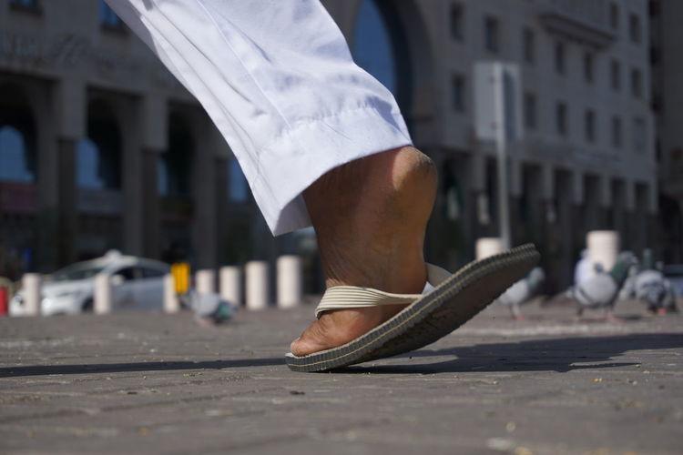 somewhere in medina EyeEmNewHere Piegion City Men Sportsman Human Leg Shoe Leg Street Close-up Architecture Foot Feet Sole Of Foot City Street Crosswalk Residential Structure Office Building Pedestrian Road Signal