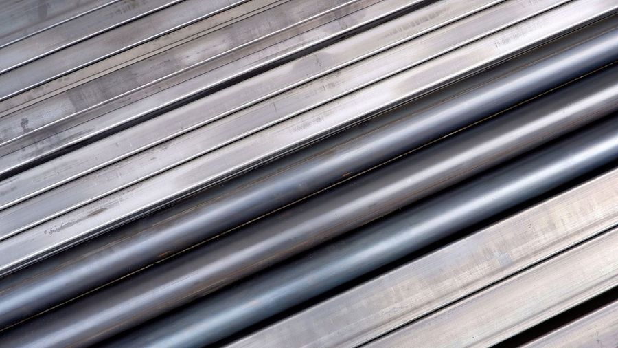 Diagonal view of carbon steel pipes and many rectangular steel tubes on the floor for background design in construction and industrial concept Carbon Pipes Tubes Metallic Materials Industry Industrial Black Gray Diagonal Construction Dite Top View High Angle View EyeEm Selects Corrugated Iron Steel Backgrounds Full Frame Textured  Pattern Metal Industry Silver - Metal Metal Silver Colored LINE Iron - Metal