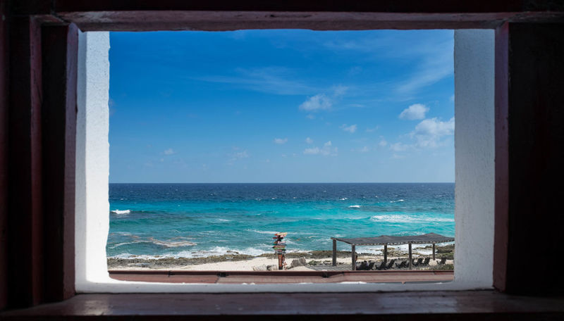 A view from the lighthouse in punta sur in Cozumel Mexico. Beach Beauty In Nature Blue Day Horizon Over Water Indoors  Leisure Activity Looking Through Window Men Nature One Person People Real People Scenics Sea Sky Tranquil Scene Tranquility Vacations Water Window