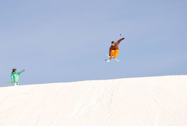 Winter extreme sports Alpine Skiing Mountain Skiing Mountain View Khibiny Mountains Ski Resort  Outdoor Activity Jump From A Springboard Springboard Ski Jumping Skiing Leisure Activity Land Nature Mid-air Vacations Lifestyles Trip Jumping Sky Sport Day Fun Real People Men Sunlight