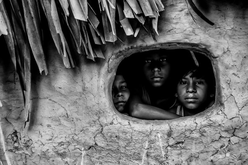 The Eyes - Stories of hidden dreams and visions behind those eyes. This spark if kept alive, will guide them a long way. All three of them belong to different families, yet the bond of friendship is sometimes much more stronger than family ties. Bengal Debarshi Mukherjee Photography Documentary Photography Environmental Portraits India Life Rural Child Childhood Culture Debarshimukherjee Girls Innocence Looking At Camera People Portrait Real People Street EyeEmNewHere