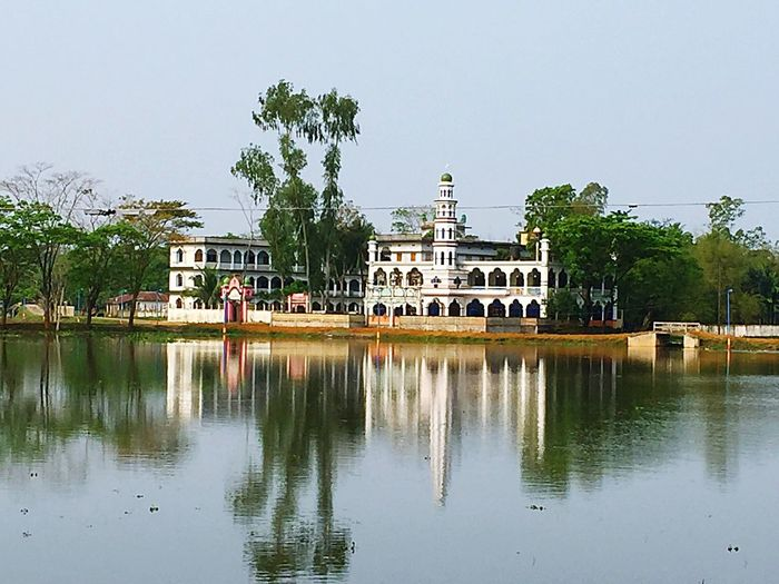Landscape Photo Of A Islamic School Bangladesh Muslim Islamic School Water Reflection Architecture Built Structure Waterfront Building Exterior Tree Day City Outdoors Clear Sky No People Sky Nature First Eyeem Photo
