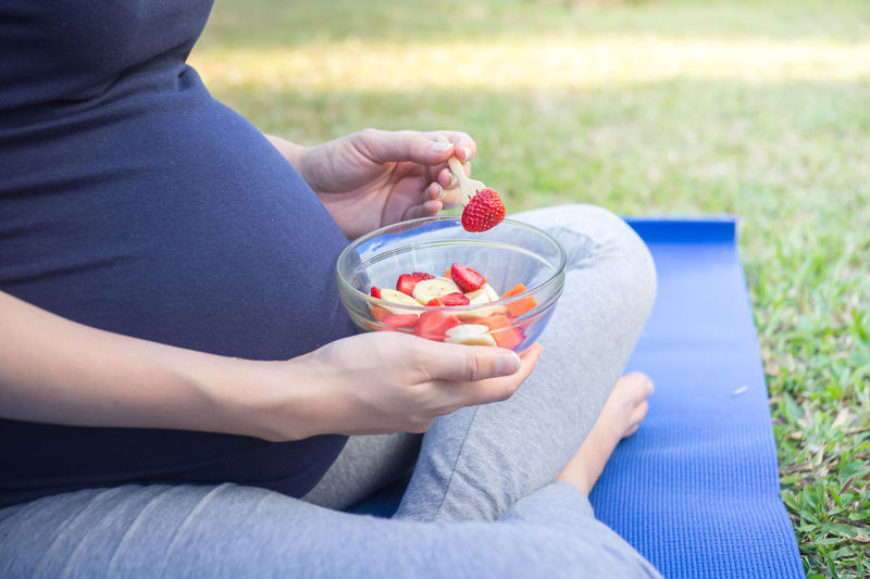 pregnancy, eating healthy pregnant women and eating healthy fruit salad in garden at home. healthy food for pregnancy. Baby Background Belly Bowl Child Day Eating Healthy Expecting Food Food And Drink Fruit Fruits Fruits Salad Happiness Healthy Eating Healthy Food Healthy Lifestyle Holding Human Hand Motherhood One Person Pregnancy Pregnancy Health Pregnant Woman Strawberry