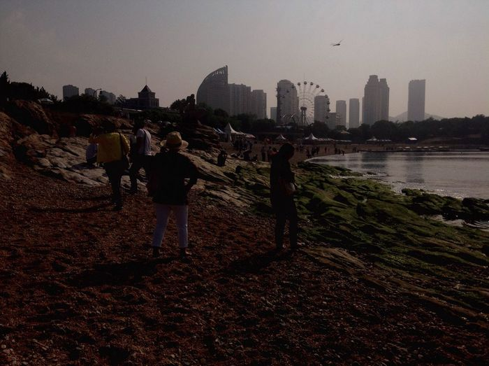 Sometimes, Life Is A Beach ! Xinghai happens to be one of my favourite Beaches in Dalian . Sure, there are more Stones and Rocks than there is sand, but you always meet Friendly Faces and get a Wonderful View . So who wants to ride the Ferris Wheel ? Ferriswheelinthecity🎡🎢 for the win!