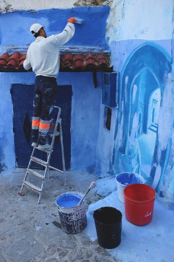 Art Blue Blue City Blue City Jodhpur Blue Wall Chaouen Chefchaouen Chefchaouen Medina Chefchaouen Rif Mountains Ladder Moroccan Art Morocco Occupation One Man Only One Person Painting Travel Destinations Travel Photography Traveling Working
