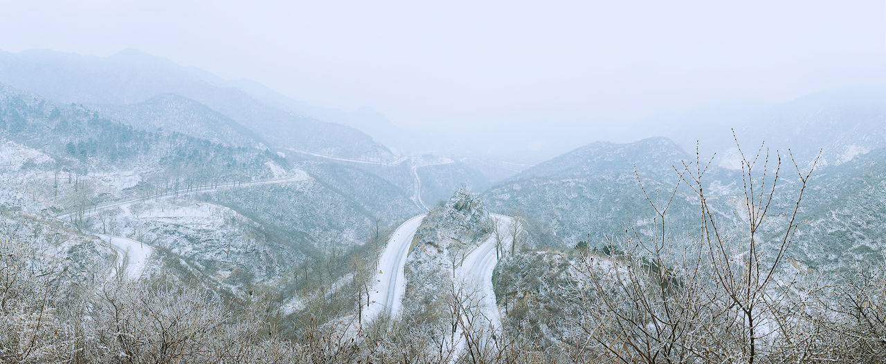 Nature Fog Day Mountain One Person Outdoors Sky People Frozen Snow Landscape Mountain Roads Scenics Weather Adventure Non-urban Scene Snowflake
