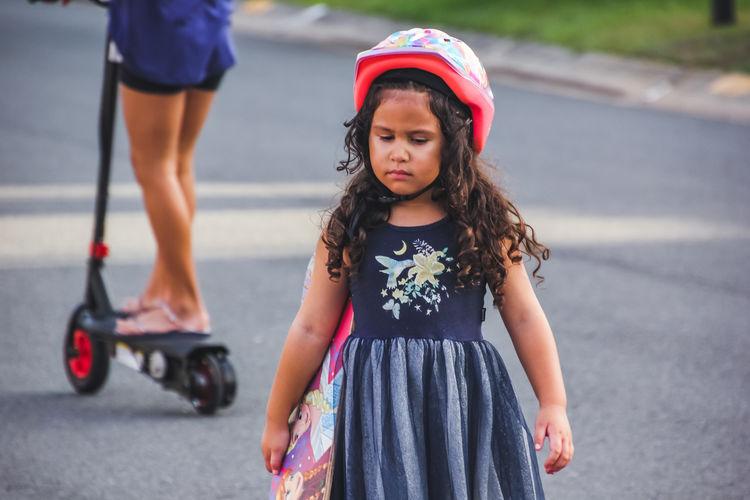 Full length of a girl standing on road