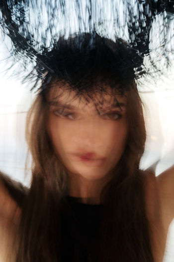 Blurred portrait of a young woman