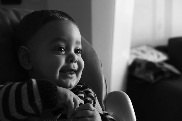 Close-Up Of Smiling Baby Boy At Home