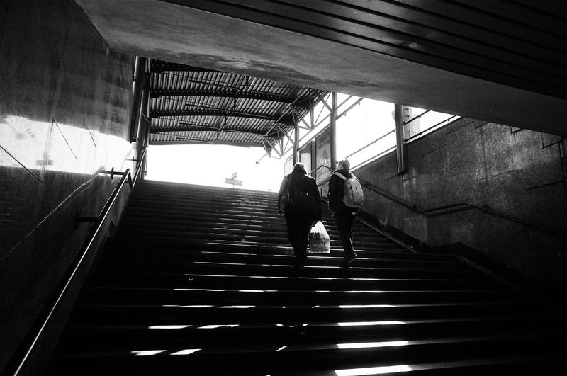 ANALOG; Rollei RPX 100 The Week on EyeEm Light And Shadow Capture The Moment Film Photography Rollei Analogue Photography Nikonphotography Street Photography Monochrome Black And White Bnw Spring Filmisnotdead Grain Staircase Steps And Staircases Architecture Real People Men Built Structure Railing Walking The Way Forward Indoors  Direction Rear View Lifestyles Group Of People Moving Up Adult Low Angle View Day Women Ceiling The Art Of Street Photography
