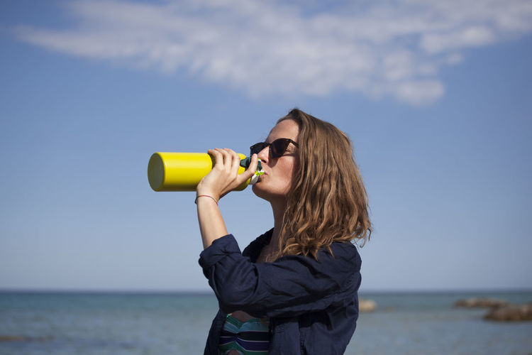 Water One Person Sea Sky Nature Leisure Activity Portrait Day Drinking Outdoors Horizon Over Water Hair Hot Dehydrated Dehydration Holiday Holidays Standing Adult Long Hair Real People