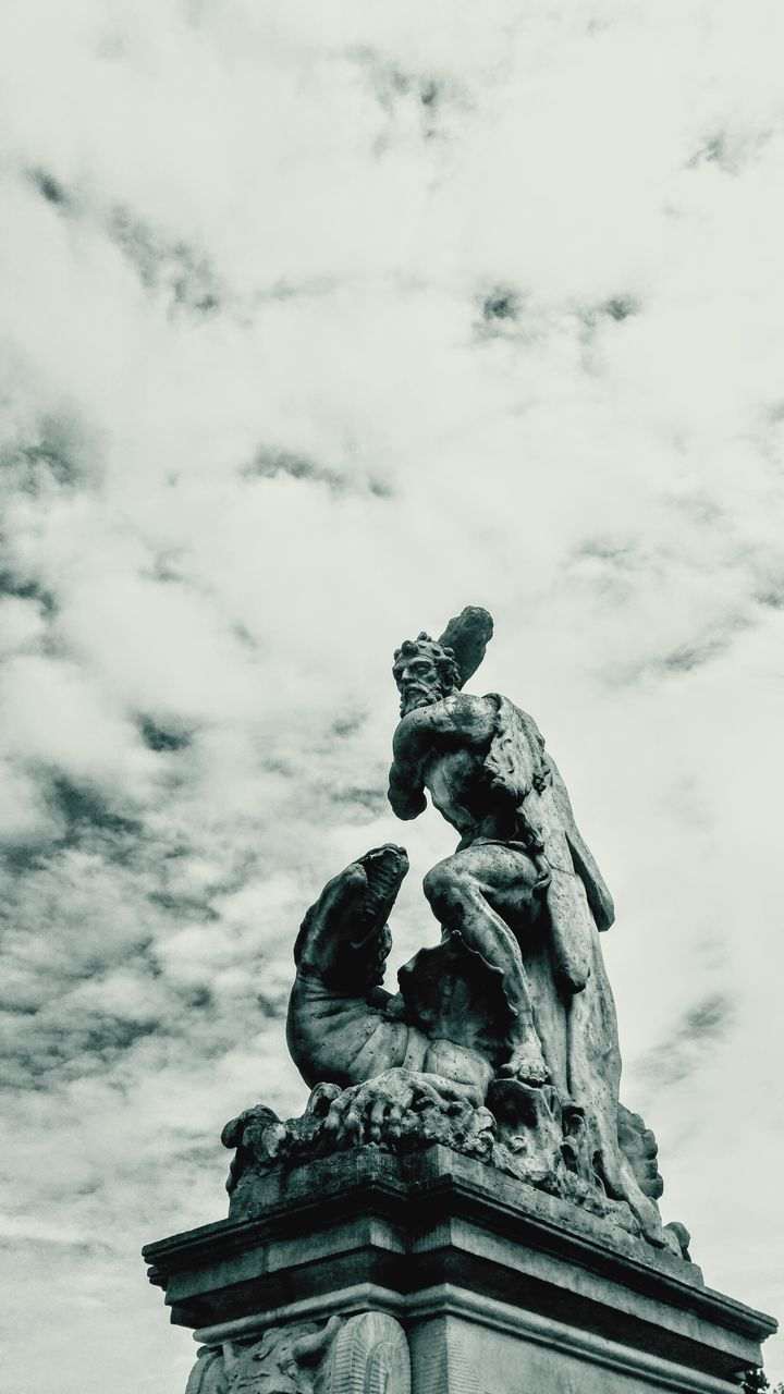 statue, sculpture, cloud - sky, sky, low angle view, human representation, art and craft, outdoors, day, no people, building exterior, architecture, gargoyle