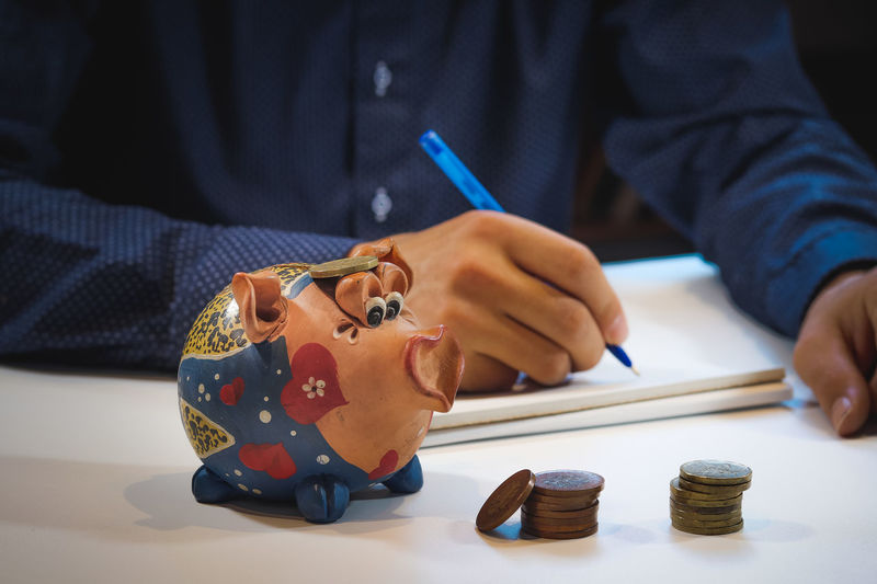 Midsection of man making face on table